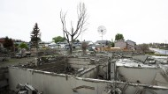 Einige Häuser sind von den Waldbränden völlig zerstört. Der Aufbau wird Jahre dauern.