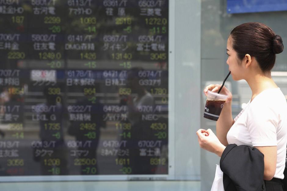 Auch in Tokio sieht man immer häufiger Starbucks Becher.