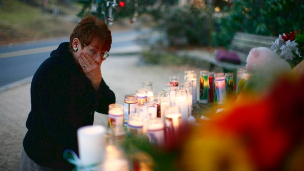A woman reacts at a memorial near Sandy Hook Elementary School in Newtown