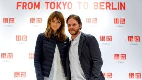 German model Padberg and German Daniel Bruehl pose in the Uniqlo Global flagship store during a preopening in Berlin