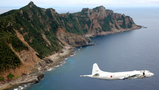 File photo of Japan Maritime Self-Defense Force's PC3 surveillance plane flying around disputed islands in the East China Sea