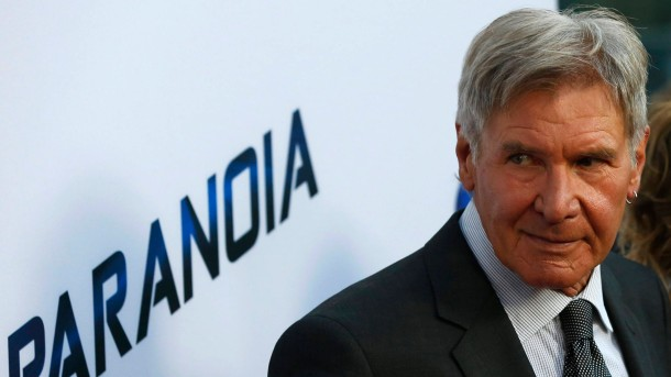 """Ford poses at the premiere of """"Paranoia"""" in Los Angeles"""