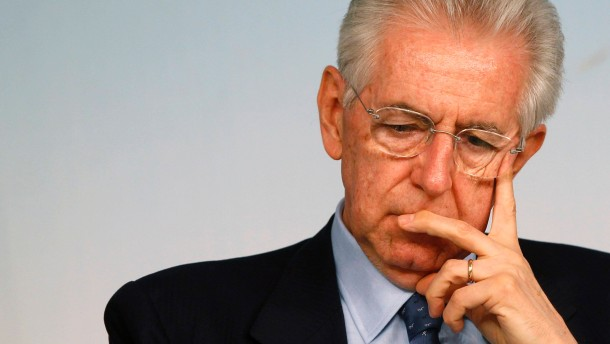 File photo of Italian Prime Minister Mario Monti attending a news conference at Chigi palace in Rome