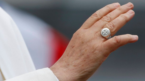 Hand of Pope Francis is seen as he conducts blessings during a weekly general audience in Saint Peter's Basilica, at the Vatican