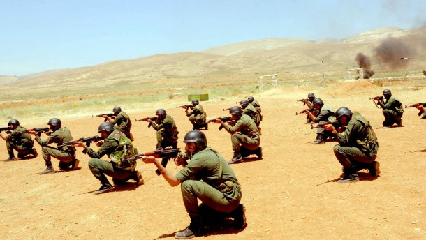 Syrian policemen in a live-fire military exercise
