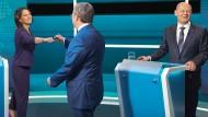 Grünen-Kanzlerkandidatin Annalena Baerbock mit Armin Laschet (CDU) und Olaf Scholz (SPD)