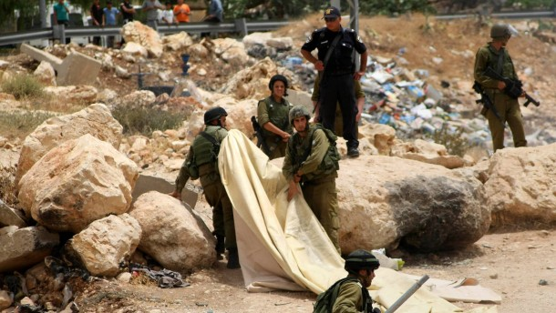 ISRAELI SECURITY FORCES REMOVE A TENT THAT PALESTINIANS SET UP A TENT DURING A PROTEST