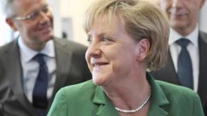 Merkel und Schäuble spielen Neutronen-Schach