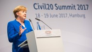 Merkel mahnt zu friedlicher Kritik an G20-Gipfel