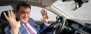 Risikoscheu sind andere: Bayerns Ministerpräsident Markus Söder (CSU) am 11. April hinter dem Steuer eines autonom fahrenden 7er BMWs in Unterschleißheim
