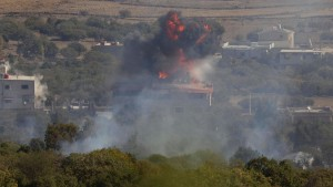 An explosion is seen in the Syrian village of Bariqa close to the ceasefire line between Israel and Syria on the Golan Heights