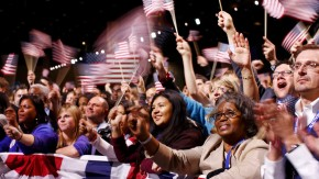 People wave flags and listen to President Barack Obamas victory speech in Chicago
