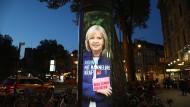 Dämmerstimmung tief im Westen? Eine Leuchtreklame für Hannelore Kraft (SPD) in Köln