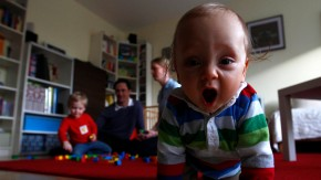 Baby Leonard plays with his brother and parents in living-room in Ismaning