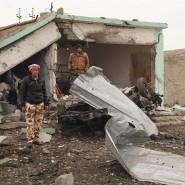 Kurdische Kämpfer nach der Befreiung eines Dorfes im Sindschar-Gebirge