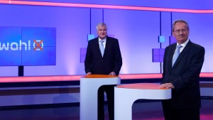 Bavarian State Premier Seehofer stands with his challenger Ude before their TV duel in Unterfeohring