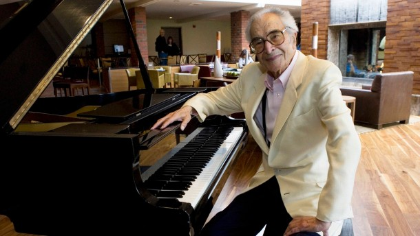 File photo of Dave Brubeck sitting next to a piano in Monterey