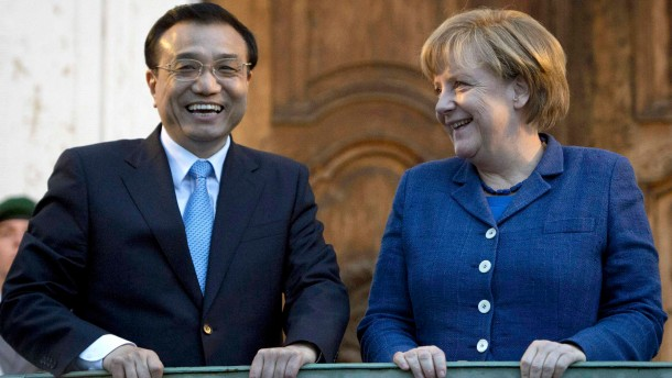 German Chancellor Merkel and China's Premier Li arrive for a dinner at the German government's Meseberg Palace in Meseberg some 60 km north of Berlin