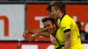 Borussia Dortmund's Reus, Goetze and Lewandowski celebrate goal during German Bundesliga soccer match against Augsburg in Augsburg