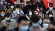 Das Smartphone, dein Freund und Notretter? Pendler in Peking
