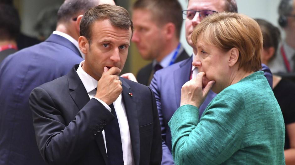 Frankreichs Präsident Emmanuel Macron und Bundeskanzlerin Merkel während eines EU-Gipfels zur Flüchtlingspolitik 2018