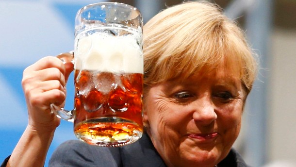 German Chancellor and top candidate for the Christian Democratic Union (CDU) Merkel toasts with beer after her speech during an electoral rally in Dachau