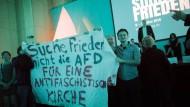 """""""Suche Frieden, nicht die AfD"""" – Protestplakat auf dem Katholikentag"""