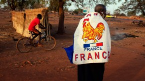 Yacouba Konate wears a French flag to show his support for the French military intervention in Mali in the Malian capital of Bamako