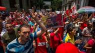 Anhänger der venezolanischen Regierung demonstrieren in Caracas