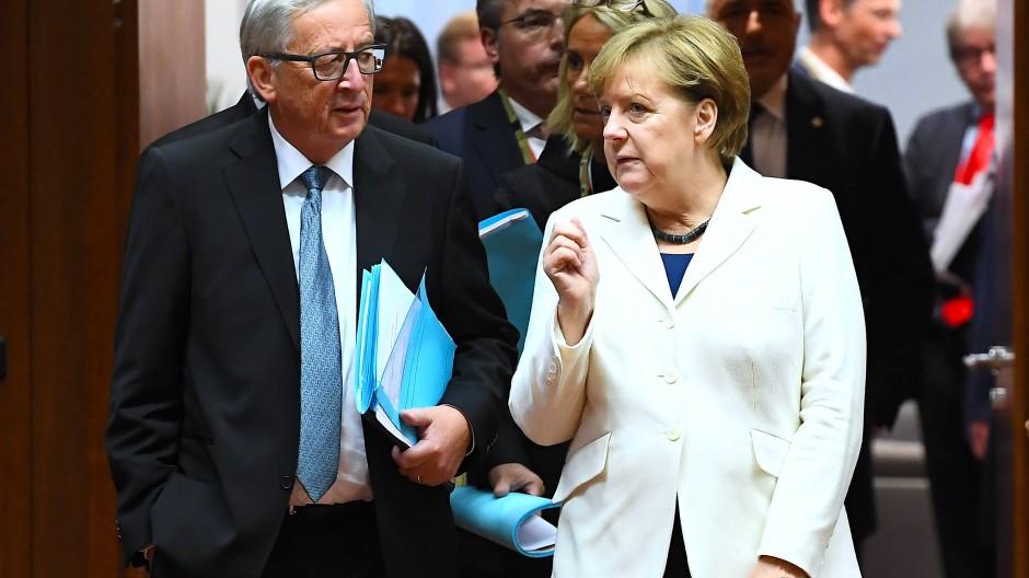 Angela Merkel und Jean-Claude Juncker können sich der Unterstützung der deutschen Wirtschaft für ihre harte Haltung sicher sein.