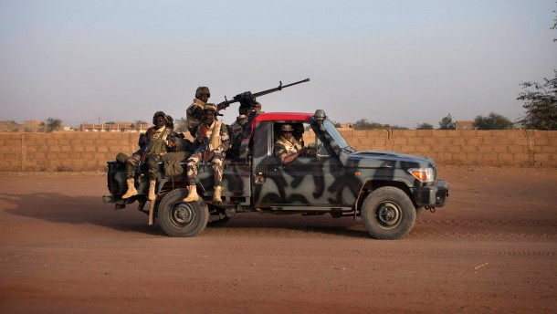 Malian soldiers patrol the streets of Gao