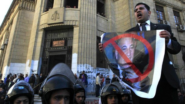 A lawyer supporting Egypt's chief public prosecutor Talaat Ibrahim protests near a High Court in Cairo
