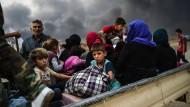 Diese Menschen sind den Fängen des IS in Mossul entkommen.