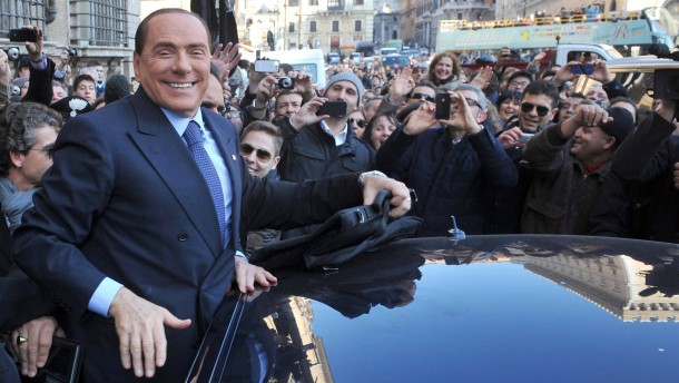 Leader of People of Freedom (PdL) party, Silvio Berlusconi, greet