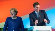 Zuversicht verströmen: Angela Merkel und Mike Mohring in Thüringen