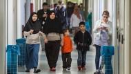 Brauchen Schutz: Frauen in hessischen Flüchtlingsunterkünften