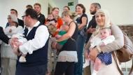 Gruppenbild mit Nachwuchs: Unter anderem sie waren 2014 in Frankfurt eingebürgert worden