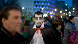A man dressed as a vampire takes part in carnival festivities in central Bilbao