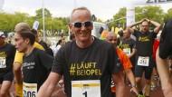 """Marathon-Mann: """"Wenn ich nicht laufe, bin ich unausgeglichen"""", sagt Opel-Chef Neumann"""