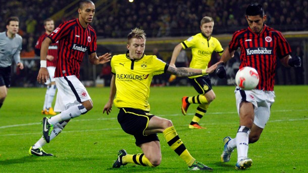 Eintracht Frankfurt's Anderson tackles Borusia Dortmund's Mario Goetze during the German first division Bundesliga soccer match in Dortmund