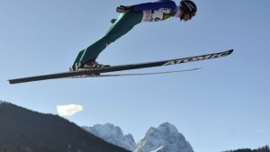 Austria''s ski jumper Loitzl soars over the Zugspitze and Waxenstein mountain during practice for second event of four-hills ski jumping tournament in Garmisch Part
