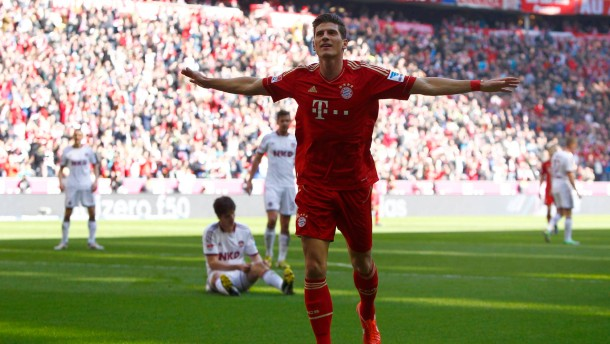 Bayern Munich's Mario Gomez celebrates a goal during the German first division Bundesliga soccer match against Nuremberg in Munich
