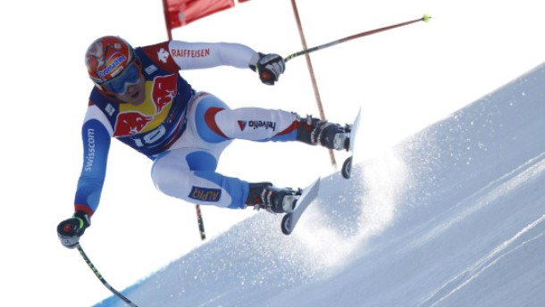 Cuche of Switzerland competes during men''s downhill race at Alpine Skiing World Cup in Kitzbuehel
