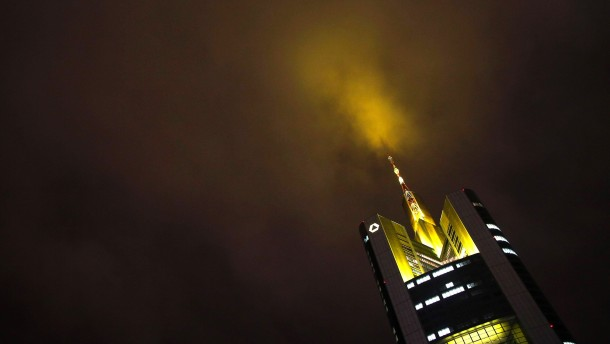 The top of the headquarters of Germany's Commerzbank is pictured under a cloudy sky in Frankfurt