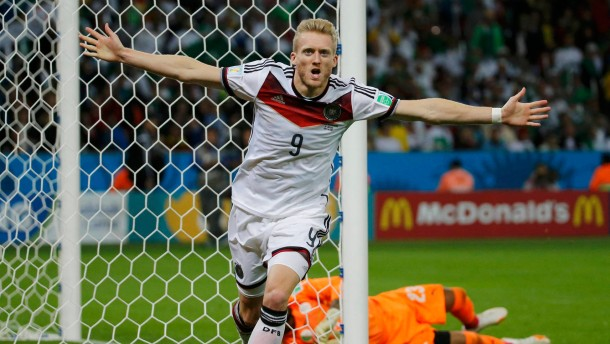 Germany's Schuerrle celebrates his goal against Algeria during extra time in their 2014 World Cup round of 16 game at the Beira Rio stadium in Porto Alegr