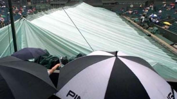 Regenschirm statt Tennisschläger - Notplan für Montag