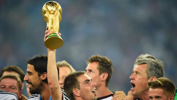 Germany's captain Lahm lifts the World Cup trophy as he celebrates with his teammates after the 2014 World Cup final between Germany and Argentina at the Maracana stadium in Rio de Janeiro