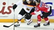 Deutschlands Leon Draisaitl gegen Österreichs Michael Raffl