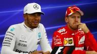 Der lachende Erste: Hamilton startet von der Pole Position, Vettel (rechts) dahinter.