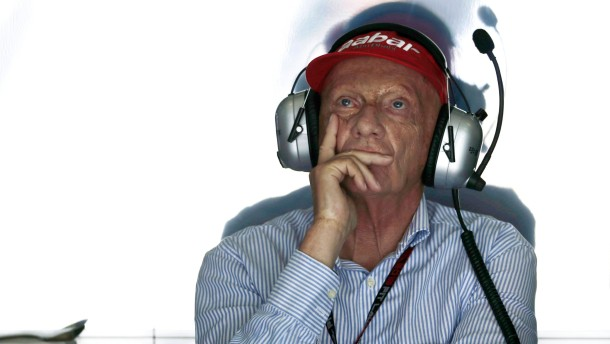 Former Formula One champion Lauda looks at the screen at the Mercedes garage during the first practice session of the Malaysian F1 Grand Prix at Sepang International Circuit outside Kuala Lumpur